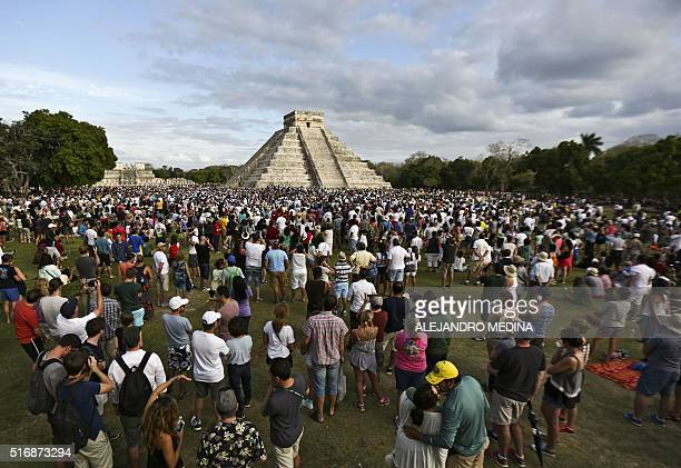 Thousands of tourists surround the Kukulcan Pyramid at the Chichen Itza archeological site during the celebration of the spring equinox in Yucatan...