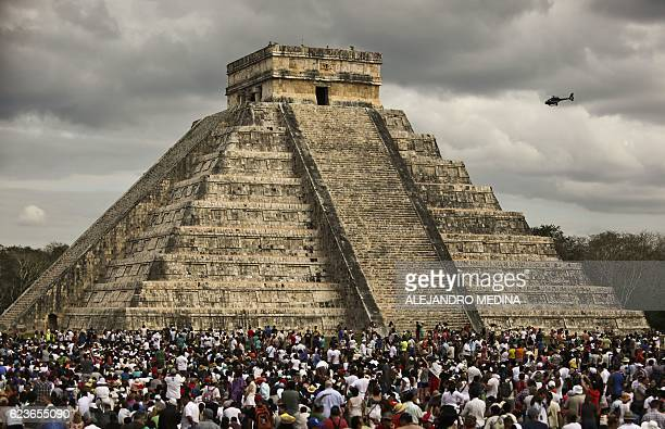 Thousands of tourists surround the Kukulcan Pyramid at the Chichen Itza archeological site during the celebration of the spring equinox in the...