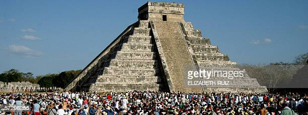 Thousands of tourists surround the Kukulkan Pyramid at the Chichen Itza archeologic site during the celebration of the Spring equinox 21 March 2006...