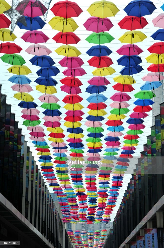 Thousands of umbrellas hang across a shopping street on December 25, 2012 in Fuzhou, China.