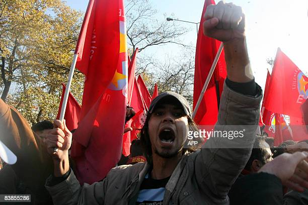 Thousands of union workers shout antigovernment slogans to protest against the global economic crisis rising unemployment and price hikes during a...