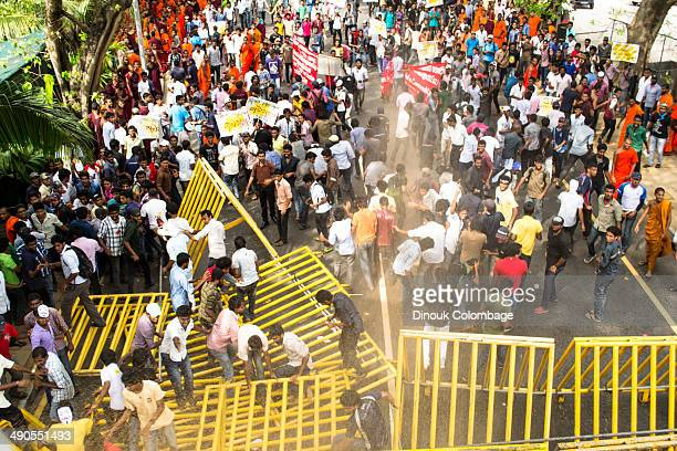 CONTENT] Thousands of University Students took to the streets of Colombo in March to protest the growing cut backs by the government to the education...