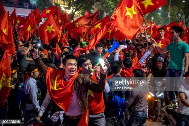Thousands of Vietnamese football fans pour into the city center to celebrate Vietnam's national U23 football team historic win over Qatar in the...