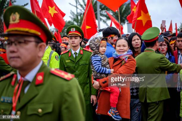 Thousands of Vietnamese soccer fans pour into Hanoi's city center to celebrate U23 Vietnam's silver medals at the Asian Football Confederation's U23...
