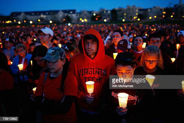 Thousands of Virginia Tech students take part in a mass candlelight vigil to honor the victims of yesterday's shootings April 17, 2007 in Blacksburg,...