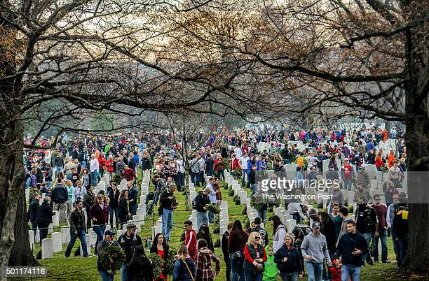 Thousands of volunteers come to participate in Wreath Across America to lay wreaths on each grave in Arlington National Cemetery on December 2015 in...