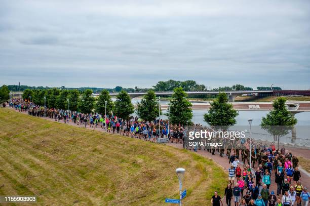 Thousands of walkers in a queue as they march during the event. The Four Days Marches are a walking achievement event for four consecutive days, in...