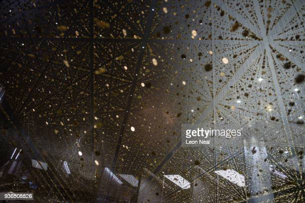 Thousands of watch mechanisms are seen in a hanging display on the Citizen stand at the Baselworld watch fair on March 22 2018 in Basel Switzerland...