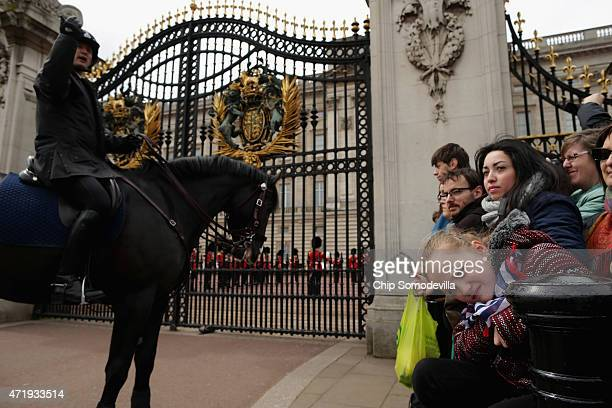 Thousands of well wishers wait for the Changing of the Guard ceremony in front of Buckingham Palace before the announcement of the birth of Prince...