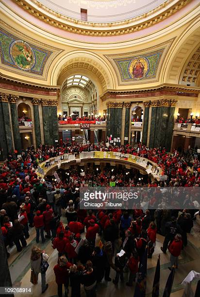 Thousands of Wisconsin teachers state workers and unions protest Gov Walker's legislation in the Capitol in Madison Wisconsin Friday February 18 2011