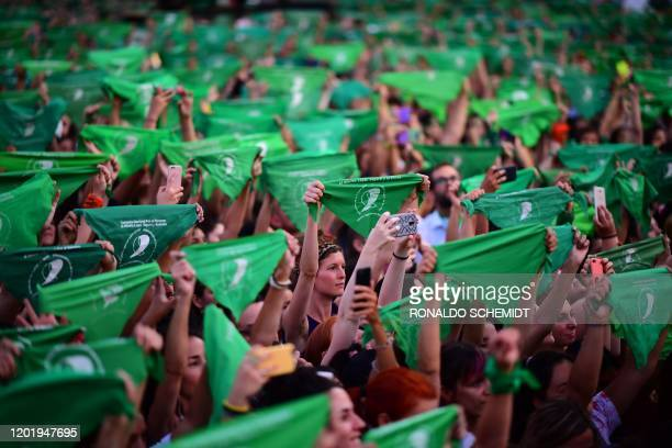 Thousands of women hold green scarves demanding the decriminalization of abortion, in Argentina, in Buenos Aires on February 19, 2020. - Abortion in...