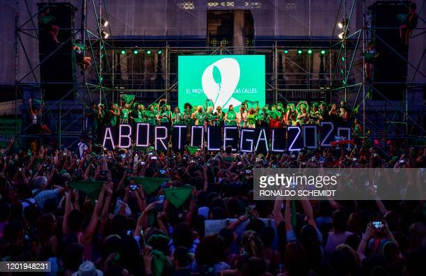 Thousands of women hold green scarves demanding the the decriminalization of abortion as they protest at Argentina's National Congress in Buenos...