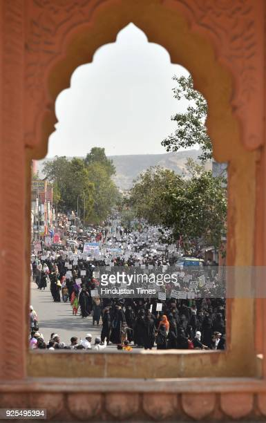 Thousands of women led by the women wing of the All India Muslim Personal Law Board took out a silent march through the streets of the old city to...