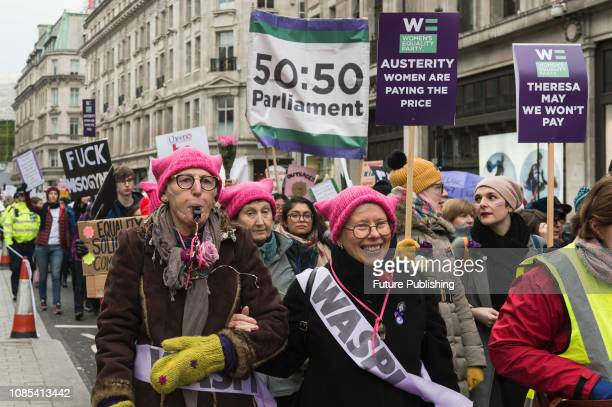Thousands of women participate in 'Women's March for Bread and Roses' in central London as part of global protest taking place in 30 countries around...