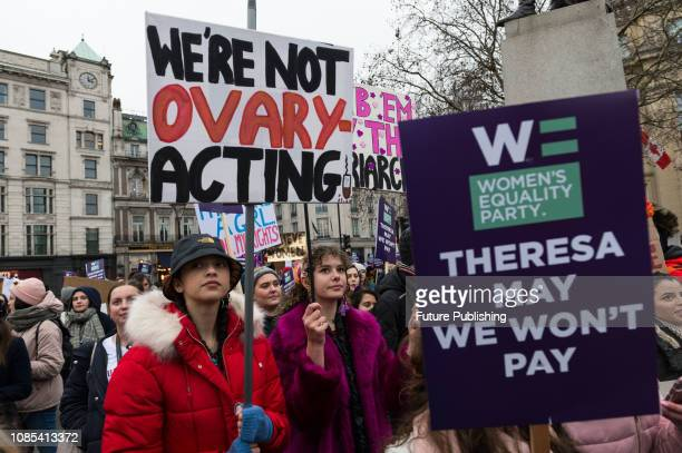 Thousands of women participate in 'Women's March for Bread and Roses' rally in Trafalgar Square which is a part of global protest taking place in 30...