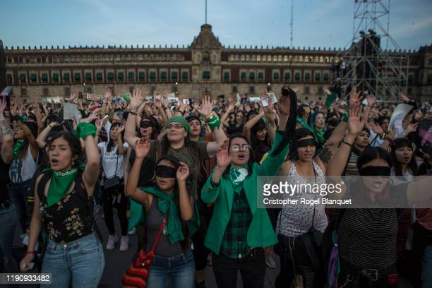 Thousands of women raise their closed hands and sing as part of the presentation 'Un Violador En Tu Camino' in the Zocalo on November 29 2019 in...