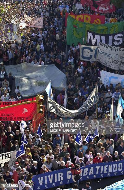 Thousands of workers angered by Argentine President Fernando de la Rua's belttightening measures protest 08 August 2001 in Buenos Aires Investors...