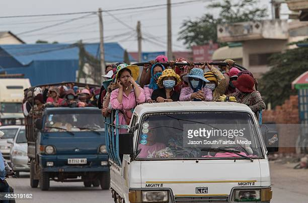 Thousands of workers every day cram together in trucks from the provinces to work in the many garment factories on May 4, 2015 in Phnom Penh,...