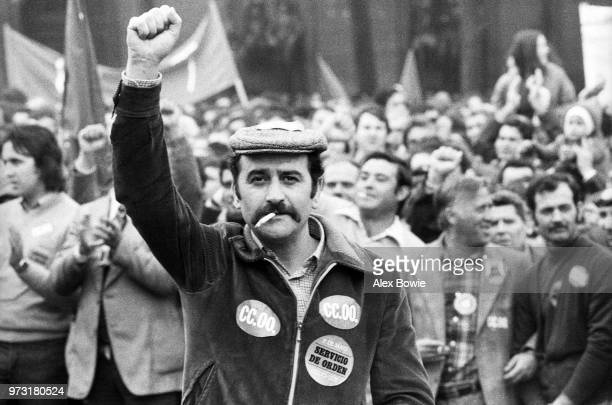 Thousands of workers gather to celebrate May Day Madrid Spain 1st May 1978 Stickers on worker's jacket signifies membership of the Workers'...