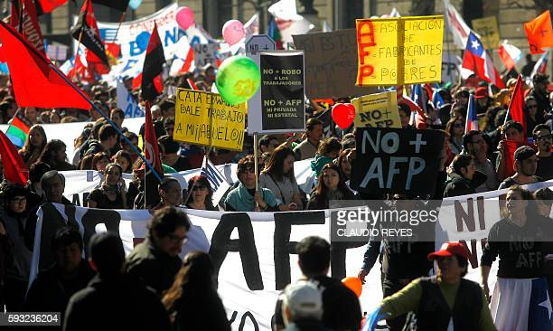 Thousands of workers march to protest against the Pension Fund Administrator in Santiago on August 21 2016 Demonstrations and marches were in several...