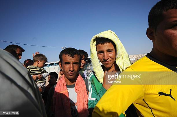 Thousands of Yazidi at the Zakho refugee camp Iraq on August 22 2014 are making a plea for better living conditions The camp currently has no proper...
