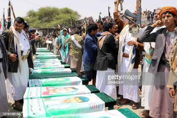 Thousands of Yemenis vent anger against Riyadh and Washington on August 13 2018 as they take part in a mass funeral in the northern Yemeni city of...