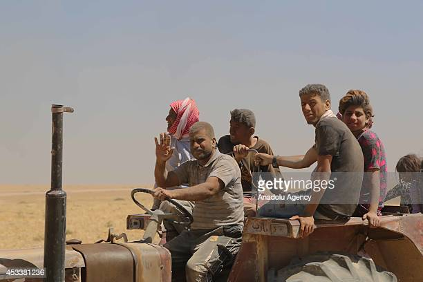 Thousands of Yezidis trapped in the Sinjar mountains as they tried to escape from Islamic State forces, are rescued by Kurdish Peshmerga forces and...