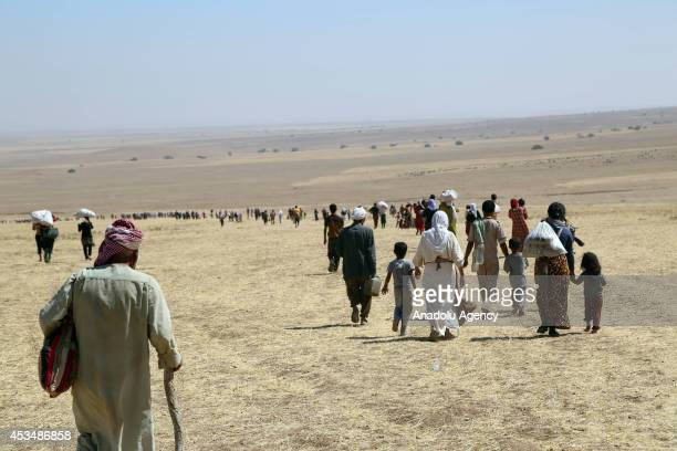 Thousands of Yezidis trapped in the Sinjar mountains without food and water for days as they tried to escape from Islamic State forces, are rescued...