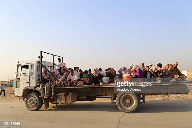 Thousands of Yezidis trapped in the Sinjar mountains without food and water for days, due to the Islamic State violence, formerly known as Islamic...