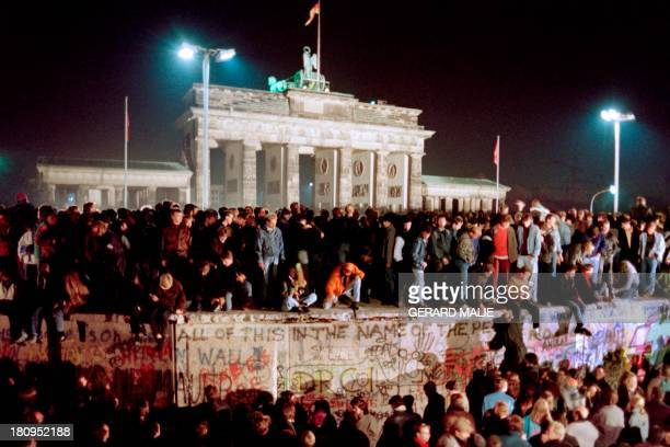 Thousands of young East Berliners crowd atop the Berlin Wall, near the Brandenburg Gate on November 11, 1989. Two days before, Gunter Schabowski, the...