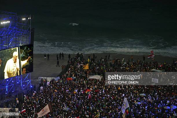 Thousands of young people gathering at Rio de Janeiro's iconic Copacabana beachfront on July 25 2013 for the welcoming of Pope Francis to World Youth...