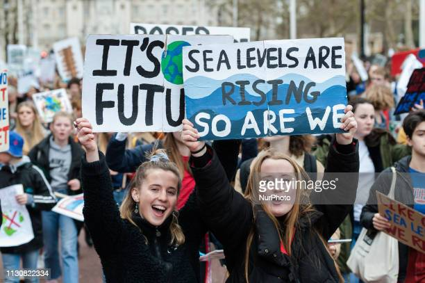 Thousands of youth strikers march along The Mall in central London as they protest against the governments lack of action on the climate change and...