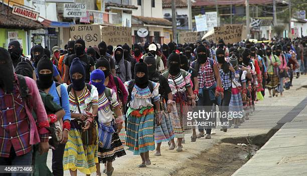 Thousands of Zapatista militias march during a demostration on October 8 2014 in San Cristobal de las Casas Chiapas state to demand justice in the...