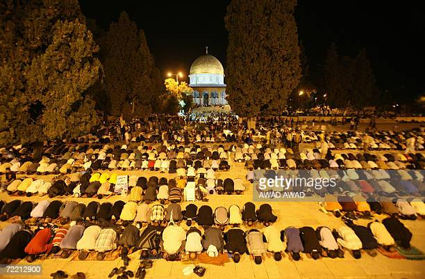 Thousands Palestinian Muslim worshippers pray in front of the Dome of the Rock Mosque in the Al Aqsa Mosque compound during Laylat Al Qadr prayers on...