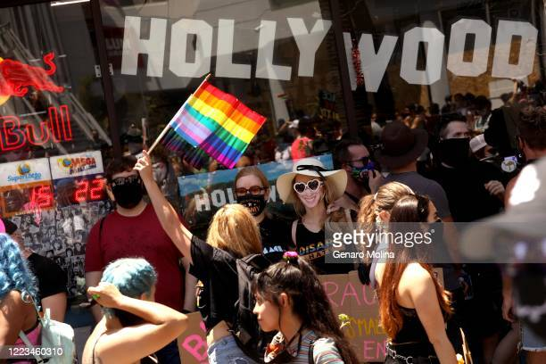 HOLLYWOOD CA JUNE 14 2020 Thousands participate in the All Black Lives Matter solidarity march to mark LGBTQ Pride Month along Hollywood Blvd in...