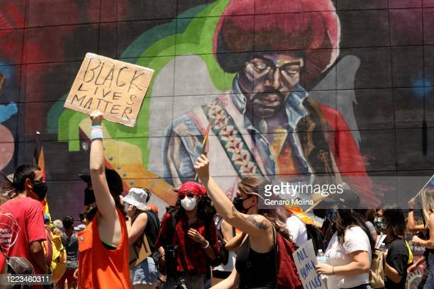 HOLLYWOOD CA JUNE 14 2020 Thousands participate in the All Black Lives Matter solidarity march to mark LGBTQ Pride Month along Sunset Blvd in...