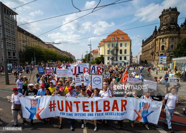 Thousands participate in the Unteilbar march against racism exclusion and exploitation and for an open society on August 24 2019 in Dresden Germany...