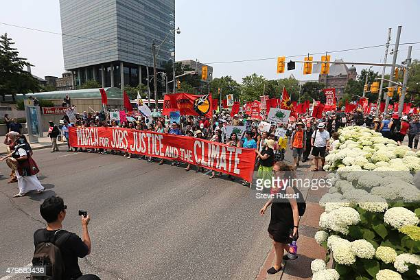 TORONTO ON JULY 5 Thousands participated in the March for Jobs Justice and Climate began at 1 pm at Queen's Park walked down University to Dundas to...
