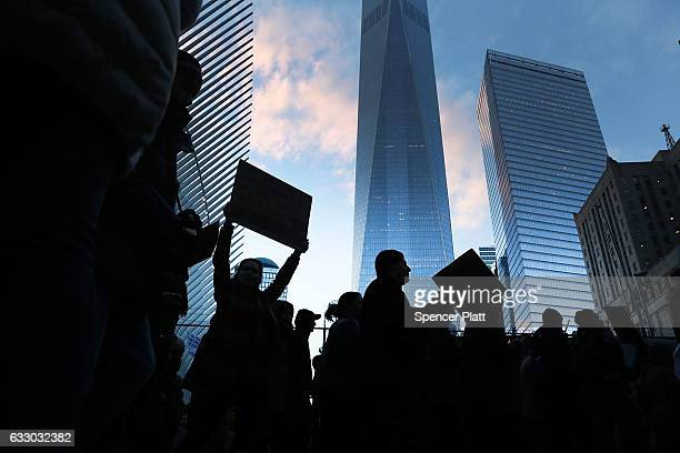 Thousands pass One World Trade during an afternoon rally in lower Manhattan to protest President Donald Trump's new immigration policies on January...