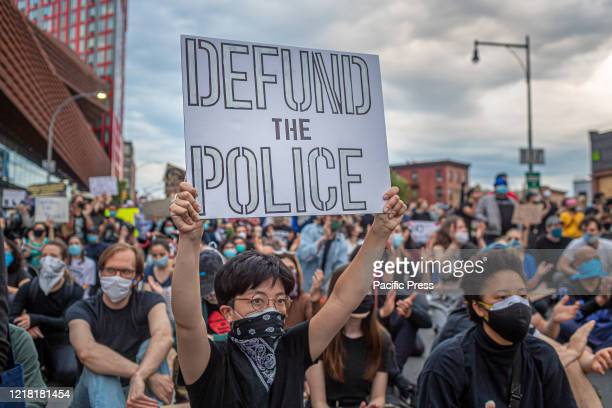 Thousands protesters continued to defy an 8 pm citywide curfew across New York City protesting the death of George Floyd police brutality racism and...