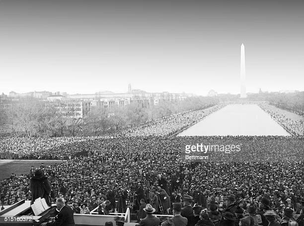 Thousands stand before the Lincoln Memorial and listen to noted African American contralto Marian Anderson give a free concert after she was barred...