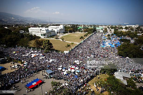 Thousands upon thousands of Haitians prayed, cried, danced and celebrated life during a massive memorial held in the Champs de Mars on February 12...