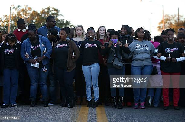 Thousands walk towards the Edmund Pettus Bridge accompanied by the cast of Selma in honor of Rev Martin Luther King Jr Day on January 18 2015 in...