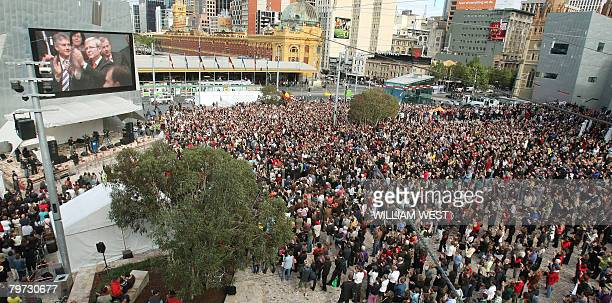 Thousands watch a giant television screen as they gather in Melbourne's Federation Square on February 13 2008 to listen to Prime Minister Kevin Rudd...