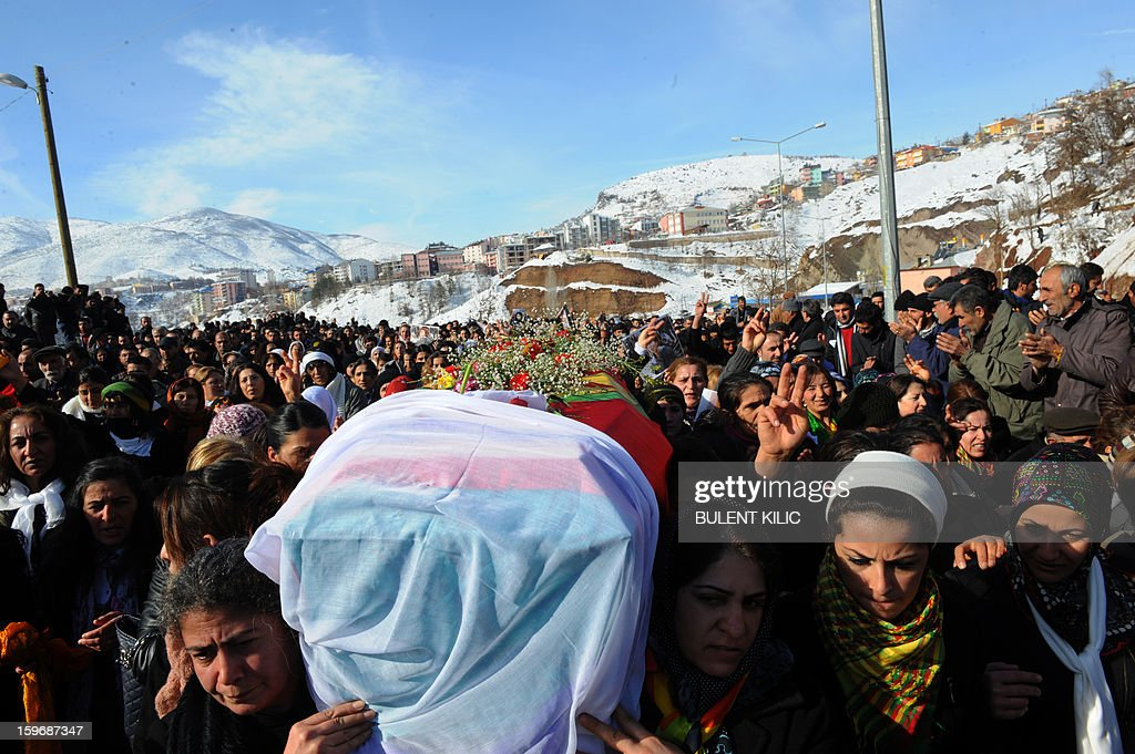 Thousnands of people follow the coffin of late Kurdish activist Sakine Cansiz, shot dead in the French capital, during the funeral on January 18, 2013 in Tunceli, her hometown in the Kurdish majority southeast of Turkey. People gathered inTunceli, to pay a final tribute to Sakine Cansiz who was assassinated in Paris last week. The growing crowd of participants, men and women adorned in white scarves, a symbol of peace, marched in a funeral many in Turkey feared would turn into a violent protest. The three women, one of them Sakine Cansiz, a co-founder of the outlawed Kurdistan Workers' Party (PKK), were found fatally shot, at least three times in their heads, at a Kurdish centre in Paris last week. French police were hunting the unknown assailants.