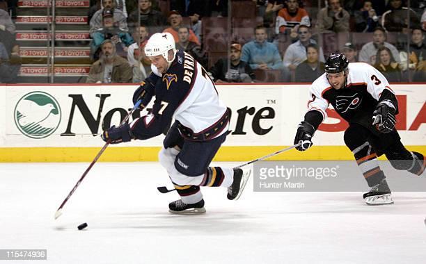 Thrasher defenseman Greg de Vries gets by Flyer defenseman Mike Rathje and scores the game winning goal in overtime vs the Flyers. Atlanta Thrashers...