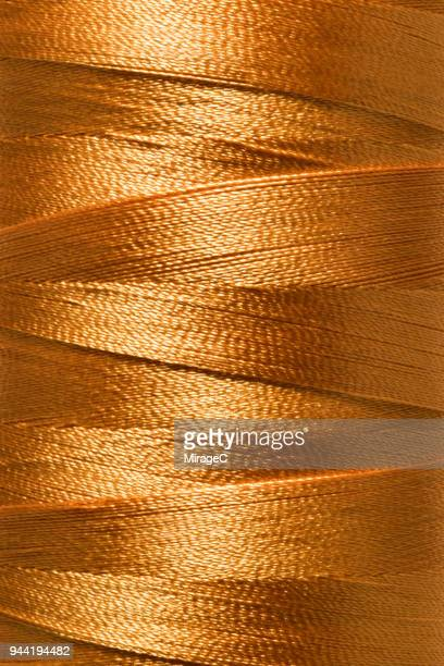 thread spool close-up shot - polyester stock photos and pictures