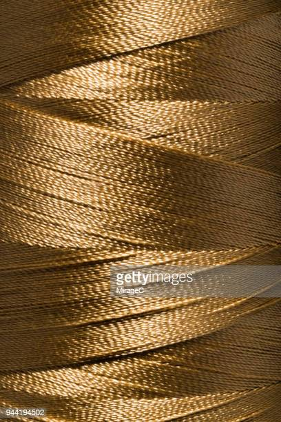 thread spool close-up shot - dark clothes stock photos and pictures