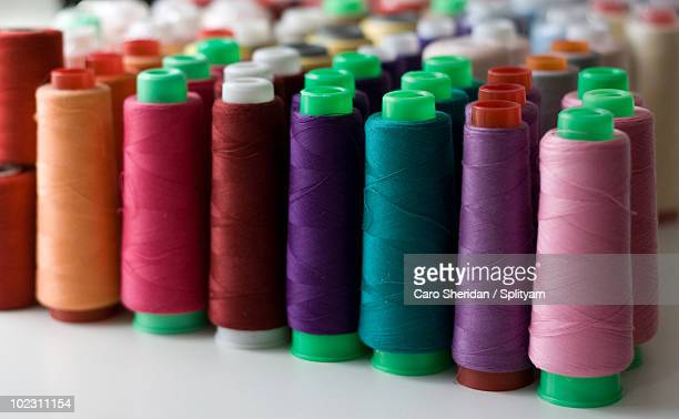 thread spool cones in a row - somerville massachusetts stock pictures, royalty-free photos & images