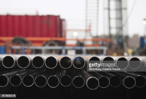 Threaded drilling pipes are stacked at a hydraulic fracturing site